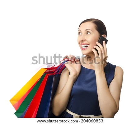 Shopping woman holding shopping bags and talking on the phone
