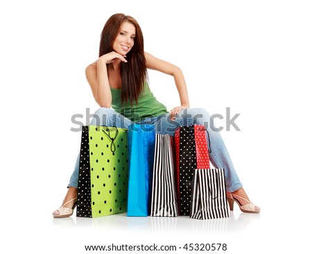 Shopping woman. Isolated over white background - stock photo