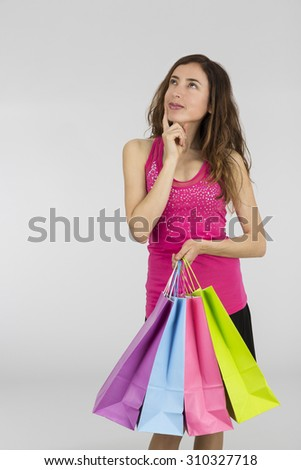 Shopping woman looking to copy space - stock photo