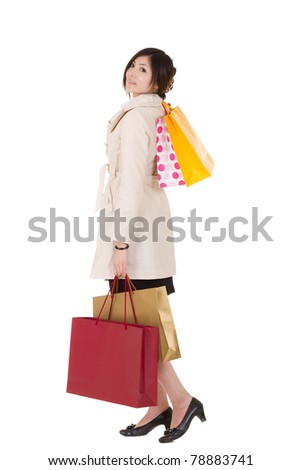 Shopping woman of Asian holding bags, full length portrait isolated on white background.