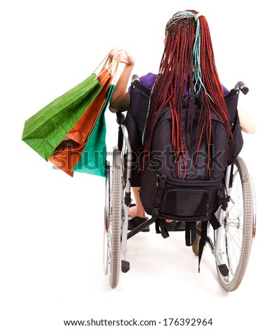 Shopping woman on wheelchair, white background - stock photo