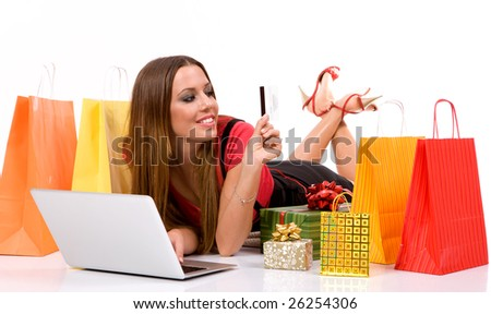 Shopping woman purchasing over internet with bags and gift all around . - stock photo