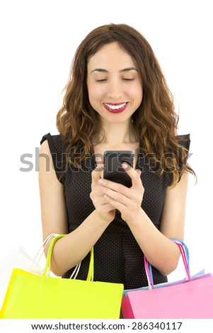 Shopping woman using her cell phone