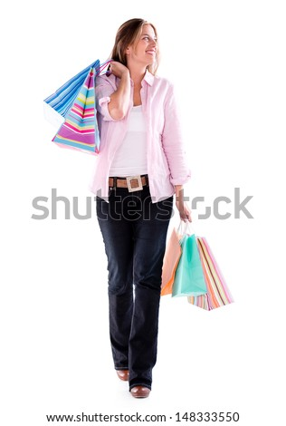Shopping woman walking and holding bags - isolated over white  - stock photo