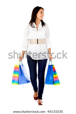 Shopping woman walking towards the camera - isolated on white - stock photo