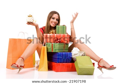 Shopping woman with colorful bags and gift boxes.