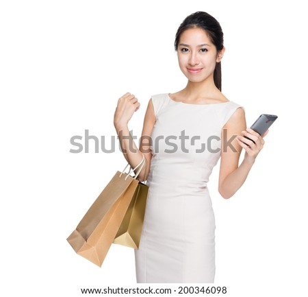 Shopping woman with mobile phone - stock photo