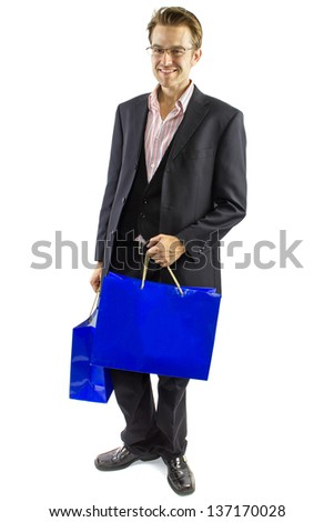 Shopping. young Caucasian male isolated on a white background holding shopping bags.