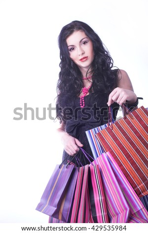 Shopping. Young happy woman with bright bags.