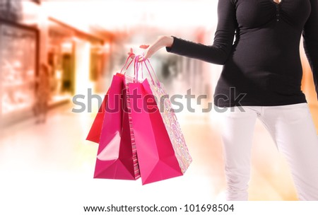 Shopping young woman in the shopping mall. - stock photo