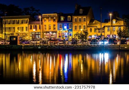 Shops and restaurants at night in Fells Point, Baltimore, Maryland. - stock photo