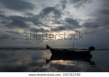 Shore fishing boat parked in the evening before sunrise to sunset.