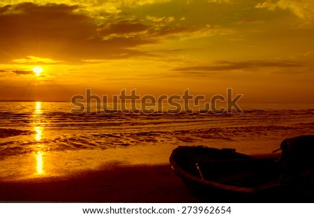 Shore fishing boat parked in the evening before sunrise to sunset. - stock photo