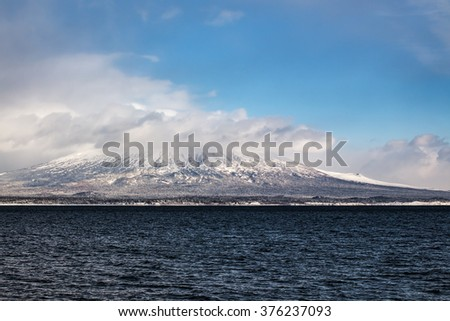 shore of the island in the winter with dormant volcanoes