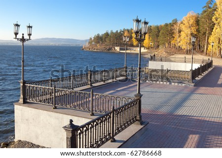 Shore of the lake with a molded fence