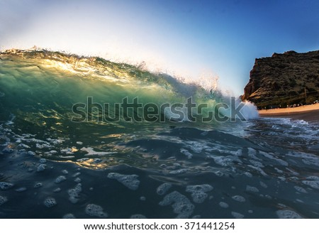 Shorebreak ocean wave in beautiful light. Surfing waves and pipeline.