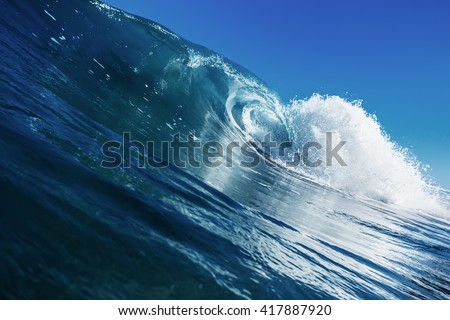 Shorebreak surfing tube wave. Pipeline in daylight with light of sun. Green Blue Ocean Water. Surfing template design with nobody. White splashes and ocean foam. Sky with no clouds. Surfing Rip Curl. - stock photo