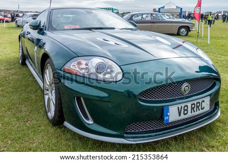 SHOREHAM-BY-SEA, WEST SUSSEX/UK - AUGUST 30 : Jaguar XK Coupe on display at Shoreham-by-Sea airfield in West Sussex on August 30, 2014. Unidentified people. - stock photo