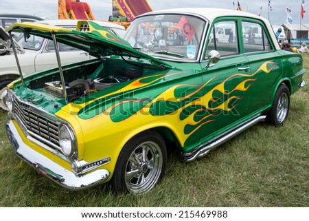SHOREHAM-BY-SEA, WEST SUSSEX/UK - AUGUST 30 : Souped up Vauxhall Victor with special paintwork parked on Shoreham Airfield in West Sussex on August 30, 2014. Unidentified people. - stock photo