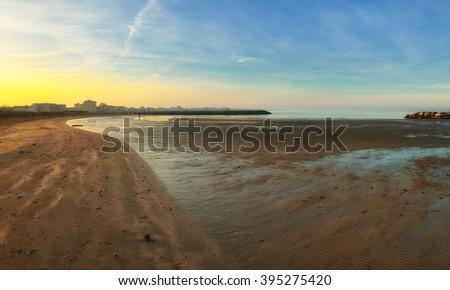 Shoreline of Rimini,Italy, at sunset in summer - stock photo