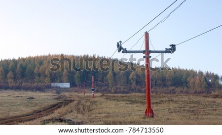 Short and red Cable electric pole at rural place