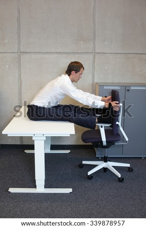 short break for yoga in the office - caucasian male professional exercising