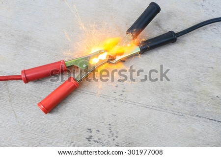 Short circuit, burnt battery cables - stock photo
