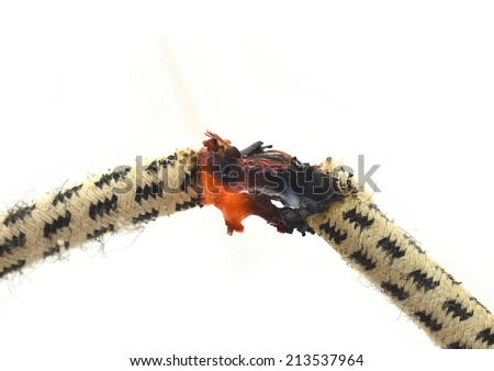 Short circuit, burnt cable Old, on white color background  - stock photo