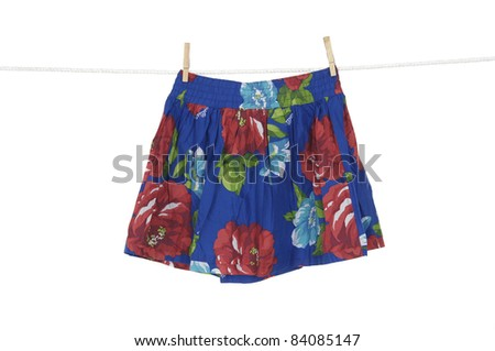 Short flower skirt on a clothespins on rope