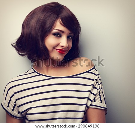 Short hair style makeup happy young woman. Vintage closeup portrait - stock photo