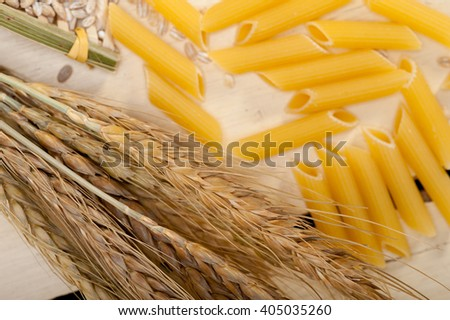 short Italian pasta penne with durum wheat grains