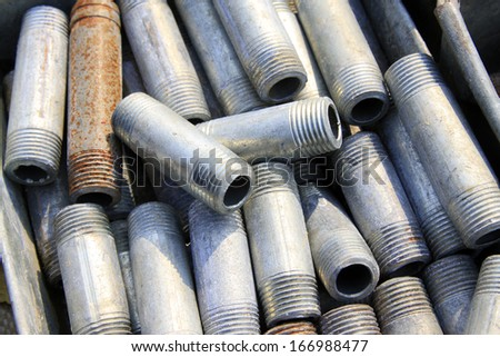 short metal pipes with external thread, closeup of photo