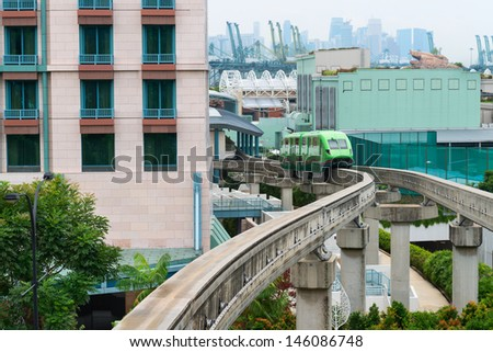 Short monorail train in bright green flower, Sentosa island, Singapore - stock photo