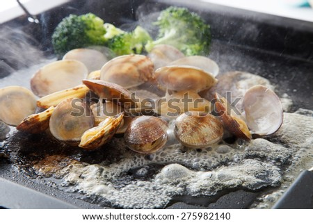Short-necked clam grilled with butter - stock photo