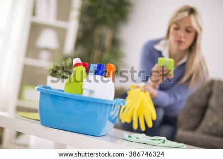 Short rest from cleaning house for cell phone - stock photo