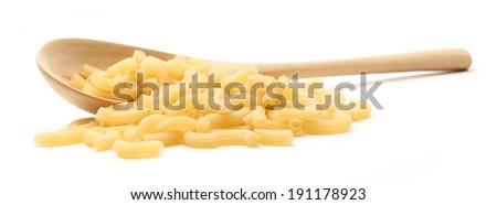 Short ribbed pasta tubes and wooden spoon