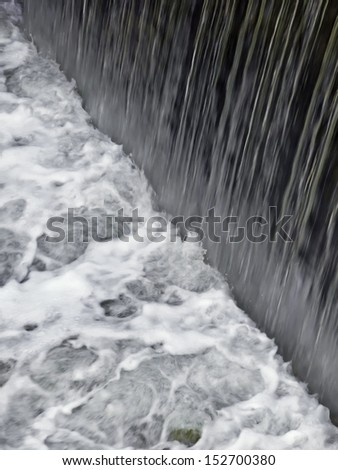 Short waterfall at a lock along the Hennepin Canal in northwest Illinois - stock photo