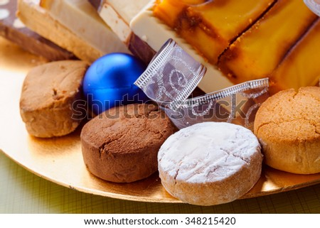 shortbread and nougat tray with christmas ornaments - stock photo
