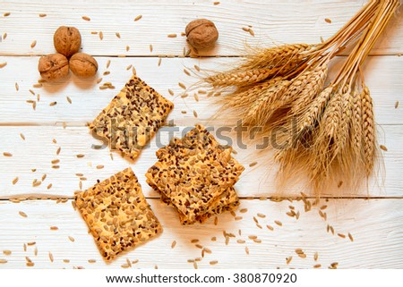 Shortbread cookies with cereals: sesame, seeds. On a white wooden background. With cones and nuts. Top view. Cooking concept. Concept of healthy food. Homemade. - stock photo