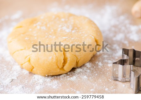 Shortcrust pastry dough, unrolled and unbaked on a floured surface, closeup, selective focus - stock photo