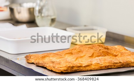 Shortcrust pastry on the wooden table. Kitchen background. - stock photo