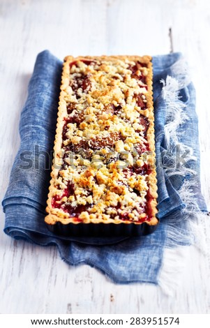 Shortcrust plum cake with coconut crumble  - stock photo