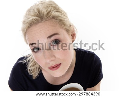 shot from above of a woman holding a cup - stock photo