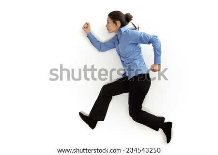 shot from above with the model lying on the ground as if she is running - stock photo