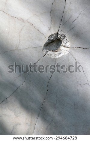 shot hole pressure cracked the marble surface.