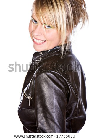 Shot of a Beautiful Blonde Girl Smiling and Looking at Camera over her Shoulder - stock photo