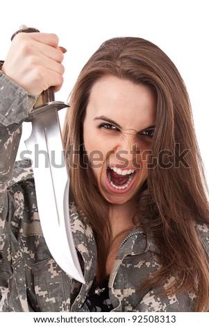 Shot of a beautiful girl holding knife - stock photo