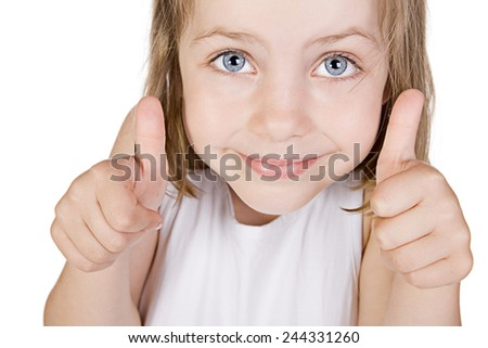 Shot of a Beautiful Little Blue Eyed Girl with her Thumbs Up against White Background - stock photo