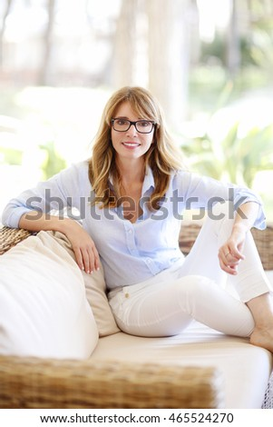 Shot of a beautiful woman wearing casual clothing while sitting on sofa and relaxing at home.