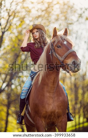 Shot of a beautiful young woman riding a horse